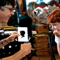 Clay Rice, children's silhouette artist at GoodHeart's childrens shop Reading MA